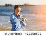 runner woman with heart rate... | Shutterstock . vector #412268572