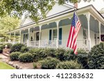White Victorian Home With...