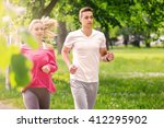 running couple jogging in park   Shutterstock . vector #412295902