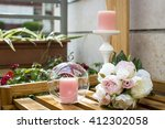 Bouquet And Pink Candles