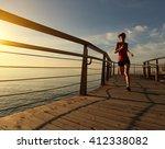 young fitness woman runner... | Shutterstock . vector #412338082