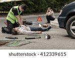 paramedic resuscitating on... | Shutterstock . vector #412339615