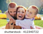 young mother being embraced by... | Shutterstock . vector #412340722