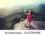 young woman hiker use... | Shutterstock . vector #412349488