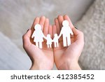 cutout figurine of a family in... | Shutterstock . vector #412385452