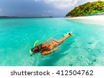 young lady snorkeling in a... | Shutterstock . vector #412504762