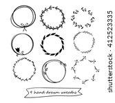 set of 9 hand drawn wreaths....   Shutterstock .eps vector #412523335