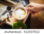 creative work with a cup of... | Shutterstock . vector #412537012