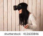 woman in virtual reality helmet.... | Shutterstock . vector #412633846