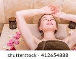 happy woman in hammam or... | Shutterstock . vector #412654888