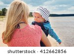 Young Woman And Baby At The...