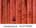 Small photo of rough and rusty corrugated iron metal surface red close-up. closer look to a similar structure maily reddish, with violet and dark blue elements