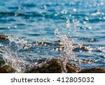 stormy waves hitting rock on a... | Shutterstock . vector #412805032