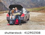 travelers by car in the... | Shutterstock . vector #412902508