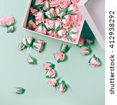 Stock photo pink roses in a white box fashion details minimalism 412938292