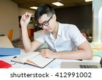 young asian student studying... | Shutterstock . vector #412991002