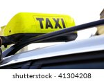 yellow taxi sign on roof of car ... | Shutterstock . vector #41304208