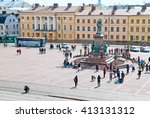 Small photo of HELSINKI, FINLAND - APRIL 23, 2016: View to the Senate Square from the lutheran Cathedral. In the center is Czar Alexander II Statue by sculptors Walter Runeberg and Johannes Takanen