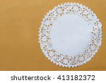 round lace doily on brown paper.... | Shutterstock . vector #413182372