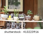 small plant pot on wood shelf ... | Shutterstock . vector #413223916