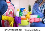 two cleaning women holding... | Shutterstock . vector #413285212