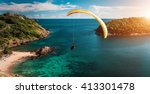 skydiver flying over the water... | Shutterstock . vector #413301478