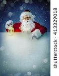 Santa Claus With Lantern On...
