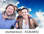 Very beautiful happy family, four members - stock photo