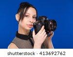 girl brunette girl holding the... | Shutterstock . vector #413692762