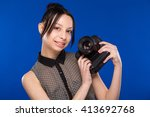young girl in a shirt looking... | Shutterstock . vector #413692768