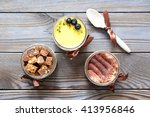 assorted jar cakes on wooden... | Shutterstock . vector #413956846