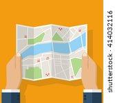 hands holding paper map. folded ... | Shutterstock .eps vector #414032116