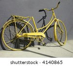 An Old Yellow Bike Leaning On ...