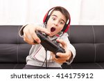 Small photo of child playing with game console