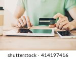 hands holding credit card and... | Shutterstock . vector #414197416
