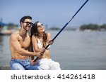 young couple in love fishing on ... | Shutterstock . vector #414261418