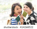 Small photo of Asian woman with her friend traveling abroad