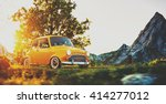 cute little retro car goes by... | Shutterstock . vector #414277012