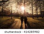 Two Elderly People Walking In A ...