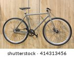 Bicycle Hanged On Wooden Wall...