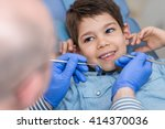 dentist doing regular dental... | Shutterstock . vector #414370036