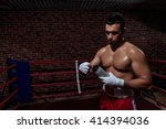young man in boxing ring | Shutterstock . vector #414394036