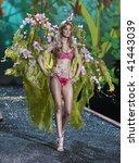 NEW YORK - NOVEMBER 19: Victoria's Secret Fashion Show model Caroline Trentini on November 19, 2009 at the Lexington Armory in New York City. - stock photo
