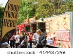 Small photo of ATLANTA, GA - APRIL 16: A sign announces the presence of food trucks to a crowd attending the Food-o-rama festival in Grant Park on April 16, 2016 in Atlanta, GA.