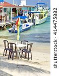 Small photo of AMBERGRIS KEY, BELIZE - CIRCA MAY 2014: Restaurant with tables on the sand in front of the inter-island ferry terminal