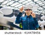 Stock photo woman wearing virtual reality glasses 414478456