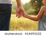 a the parent holds the hand of... | Shutterstock . vector #414493102