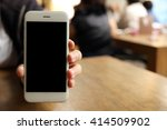 hand holding smartphone with... | Shutterstock . vector #414509902