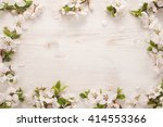 Spring Flowers Frame On Wooden...