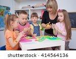 happy children with teacher... | Shutterstock . vector #414564136